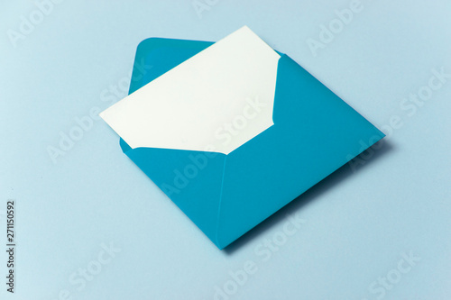 Fototapeta Blank white card with blue paper envelope template mock up obraz