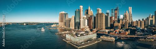 Photo  New York, New York, USA skyline with Brooklyn and Washington bridges near the Manhattan island