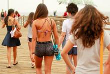 Group Of Girls Walking On Pier...