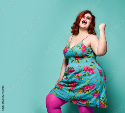 Lucky laughting loud plus-size lady overweight woman in fashion sunglasses and c Canvas Print