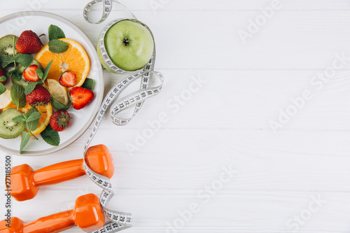 Diet plan, menu or program, tape measure, water, dumbbells and diet food of fres Canvas Print