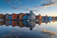 Tranquil Sunrise At Colorful Wooden Houses In A Small Marina In The Netherlands.  Living At The Waterfront In Groningen.