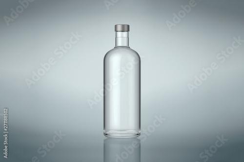 Fotografia  Clear wine or vodka bottle with silver cap
