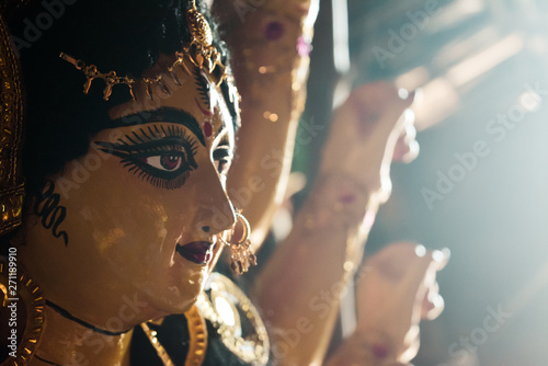 Close up side view face of Goddess Maa Durga Idol. A symbol of strength and power as per Hinduism. Portrait was taken during Durga Puja celebrations from a famous potter studio in Kumartuli in Kolkata