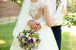 canvas print picture - Groom are hugging the bride with purple flower wedding bouquet