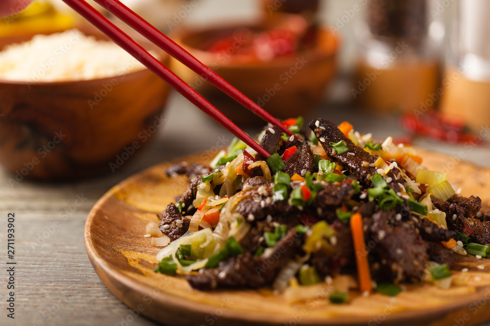 Fototapeta Traditional Korean Bulgogi dish.  Thinly cut, grilled beef, served with rice and vegetables.