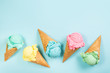 canvas print picture - Pastel ice cream in waffle cones, bright background, copy space