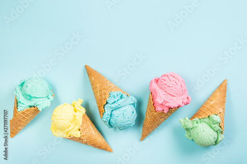 Tablou Canvas Pastel ice cream in waffle cones, bright background, copy space
