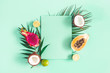 canvas print picture Summer composition. Tropical palm leaves, fruits, paper blank on mint green background. Summer concept. Flat lay, top view, copy space