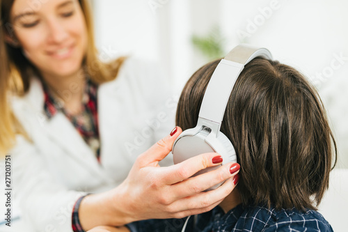 Hearing Test for Children - Audiologist Working with a Little Boy - 271203751