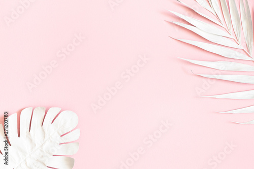 Summer composition. Tropical palm leaves on pink background. Summer concept. Flat lay, top view, copy space