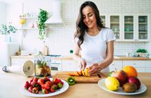 Beautiful Woman Making Fruits ...