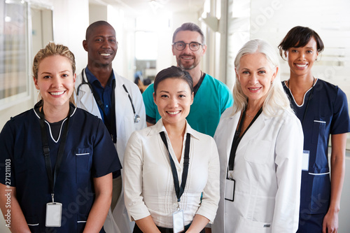 Fotografiet  Portrait Of Medical Team Standing In Hospital Corridor