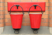 Two Red Vintage Metal Fire San...