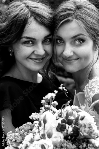 Fotografie, Tablou stylish happy guests and bride and bridesmaids having group photos on the sunny