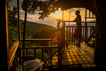 Woman At Sunset In A Treehouse...