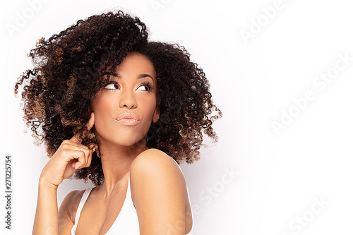 Young afro girl posing in studio. Canvas Print