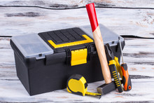 Tool Box And Different Tools On Wooden Background. Builder Ruler, Hammer, Pliers, Screwdriver And Tool Box. Construction Concept.