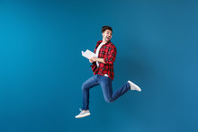 Jumping Young Man With Book On...