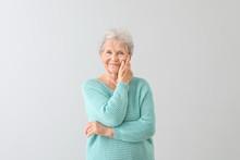 Portrait Of Senior Woman On Li...