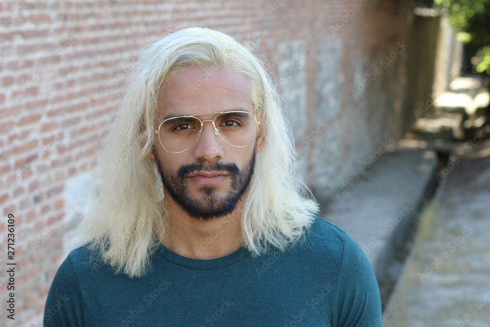 Fototapety, obrazy: Ethnic man with blonde dyed long hairstyle
