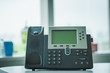 Close up soft focus on ip phone devices at office desk