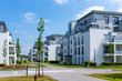 canvas print picture modern real estate and condominium with several apartments and penthouses white and gray facade surrounded by clean grassy areas