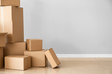 Cardboard Boxes Near Light Wall