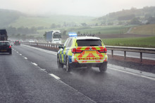 Police Siren Flashing Blue Lights On Motorway In Bad Weather Conditions