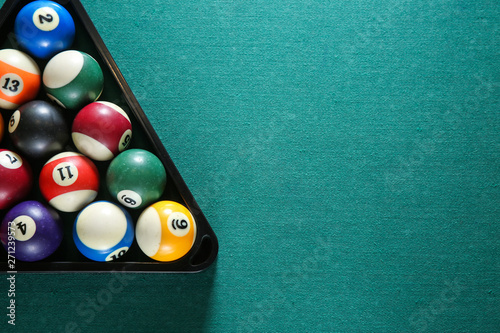 Photo Billiard balls in triangle rack on table