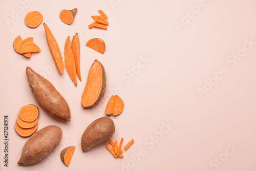 Fresh sweet potatoes on light background