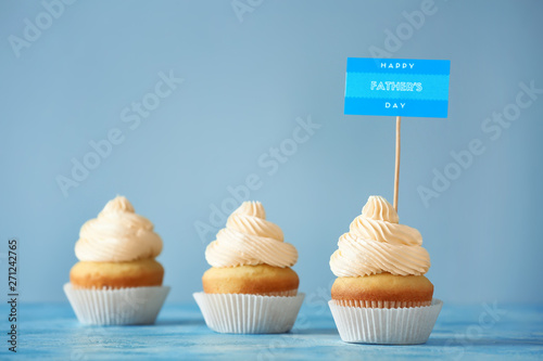 Tasty cupcakes for Father's Day on color background Canvas Print