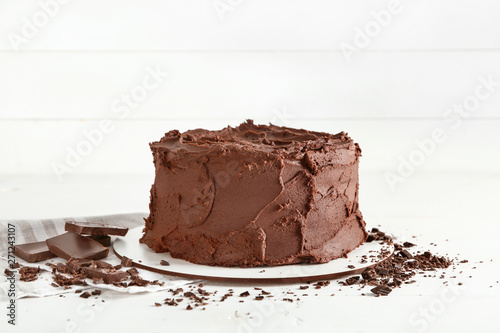obraz lub plakat Tasty chocolate cake on white background
