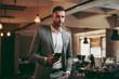 Portrait of attractive businessman in gray suit