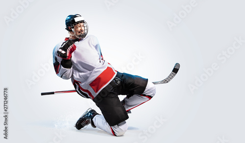 Hockey player isolated in white background celebrate win Wallpaper Mural