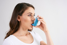 Asthmatic Woman Using An Asthm...