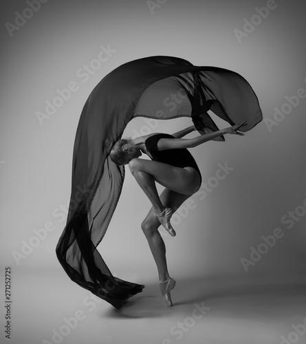 Fototapeta  Girl with flying black cloth. Black and white photo.