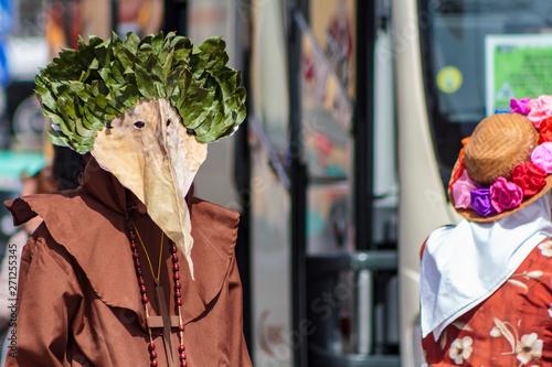 Masked man at Iberian Mask International Festival in Lisbon Fototapet