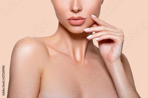 Beauty. Closeup Model lips beige in Studio. - image Tableau sur Toile