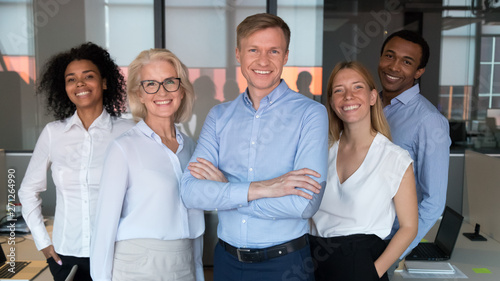 Fotografía Successful team leader and diverse employees posing for photo together