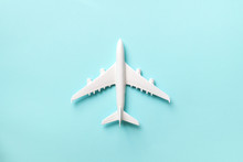 Creative Layout. Top View Of White Model Plane, Airplane Toy On Pink Pastel Background. Flat Lay With Copy Space. Trip Or Travel Banner