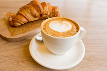 Cappuccino And Croissant With ...