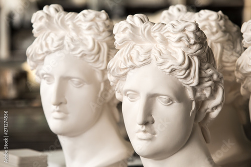 Fototapety, obrazy: Gypsum sculptures. The heads of the gypsum apollo in the workshop.