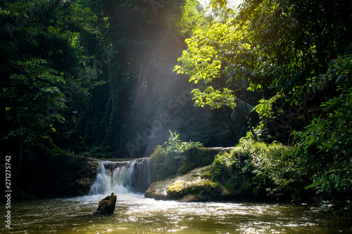 Acrylic Prints Forest river Mini waterfall and sunset sunny beams, travel destinations background, Forest viwe river Kroeng Krawia Waterfall, Kanchanaburi, Thailand