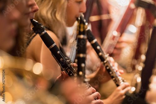 Fotografiet wind section during a classical concert music, close-up.