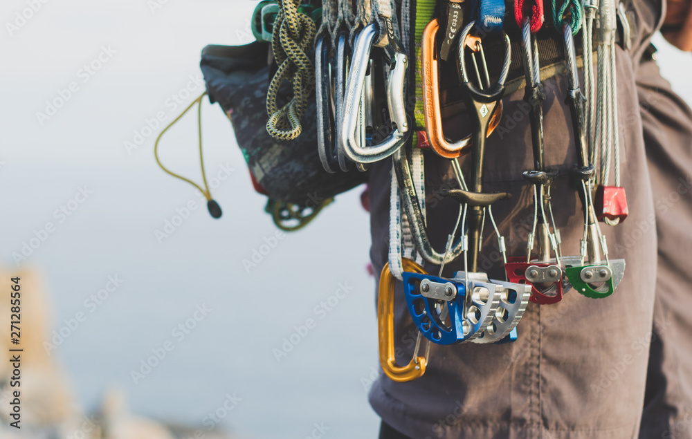 Fototapety, obrazy: Rock climbing gear attached to harness