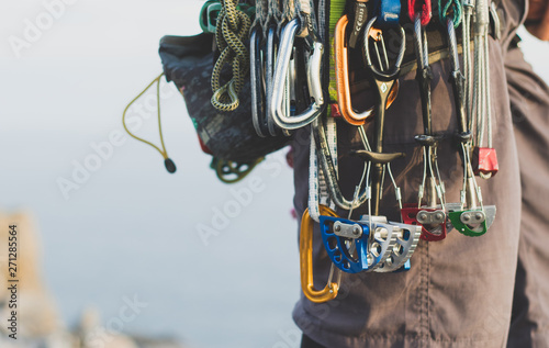 Fototapeta Rock climbing gear attached to harness