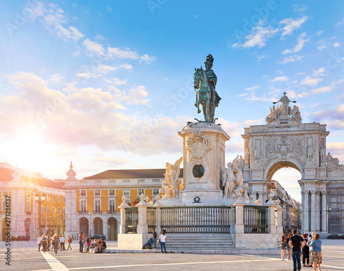 Lisbon, Portugal. King Jose I Statue at Praca do Comercio in front of Triumphal Arch near waterfront. Old town of Lisboa in historic midtown Alfama district. Evening sunset and blue sky with clouds. Fototapete