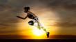 Leinwandbild Motiv Sporty young woman running on sunset background