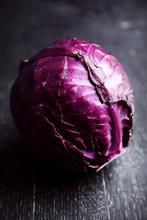 Fresh Red Cabbage On Black Wooden Table